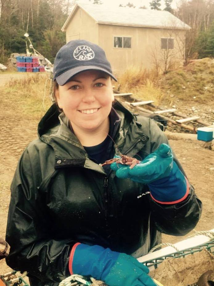 Liz holding a 1-year-old lobster caught in a lobster collector in False Bay, Cape Breton